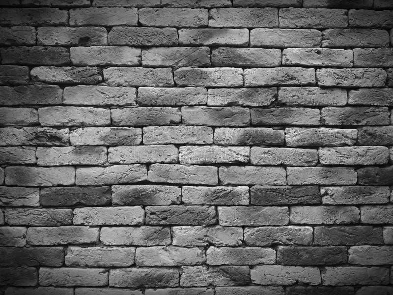 Vignetting doorstond textuur van bevlekte oude zwart-witte bakstenen muurachtergrond, grungy roestige blokken van het steenwerk stock fotografie