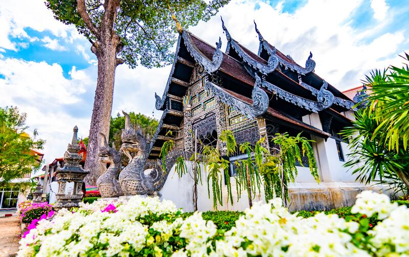 Vihara of Liang Pu Mun in Chiang Mai city, Thailand. Old ancient religion building, spiritual place. Big snake statue before. Temple. House is placed near Wat stock photo
