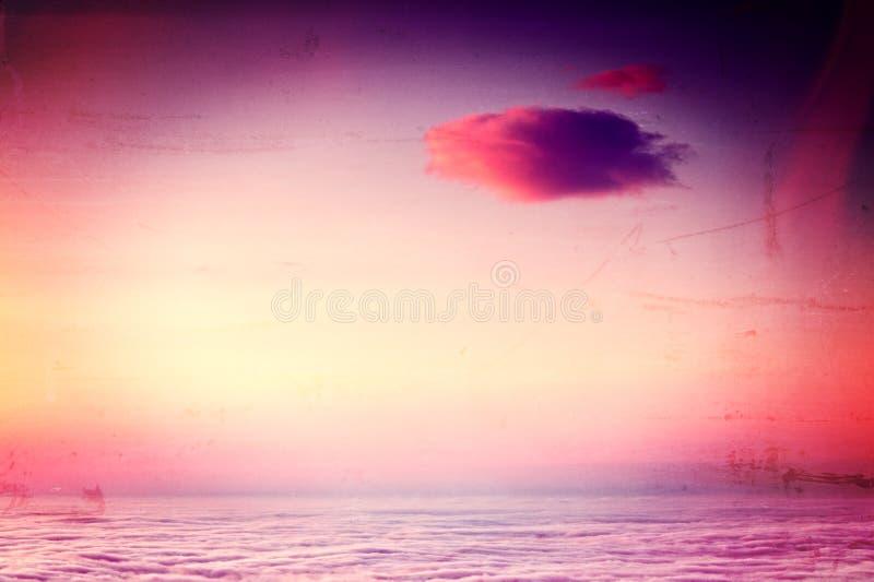 Viintagestijl van mooie zonsopganghemel stock foto