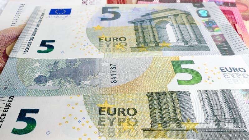 Vijf Euro geldachtergrond stock foto's