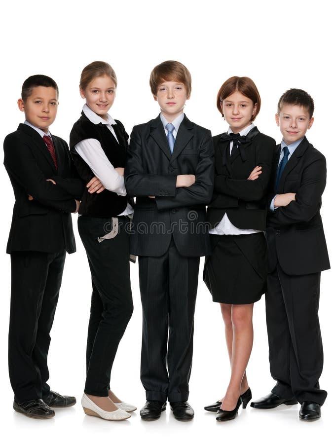 Vijf glimlachende studenten royalty-vrije stock afbeeldingen