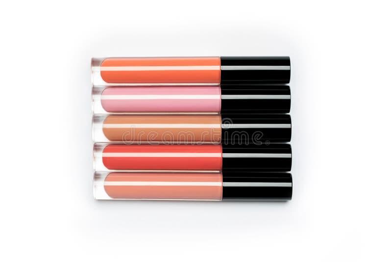 Vijf helder gekleurde flessen van vloeibare lippenstift en lipgloss royalty-vrije stock afbeeldingen
