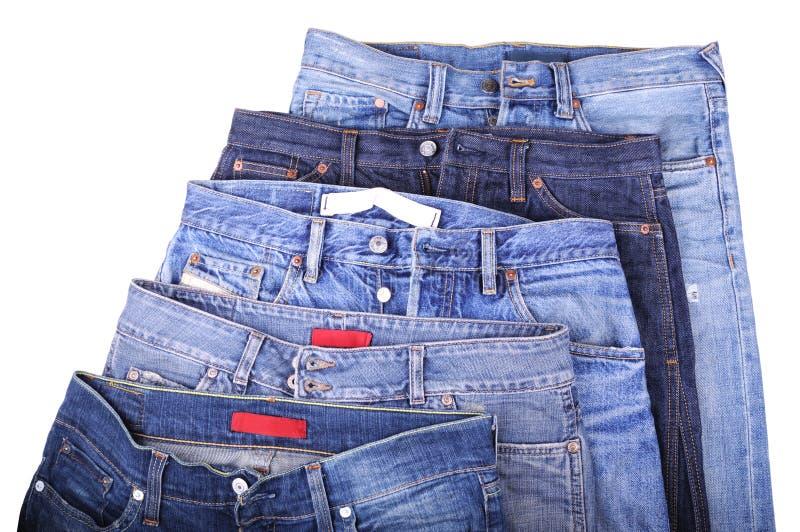 Vijf jeans stock afbeelding