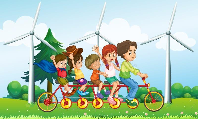 Vijf jonge geitjes die bij de fiets dichtbij de windmolens berijden stock illustratie