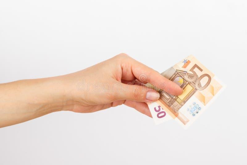 Vijftig euro in de vrouwen` s hand royalty-vrije stock foto