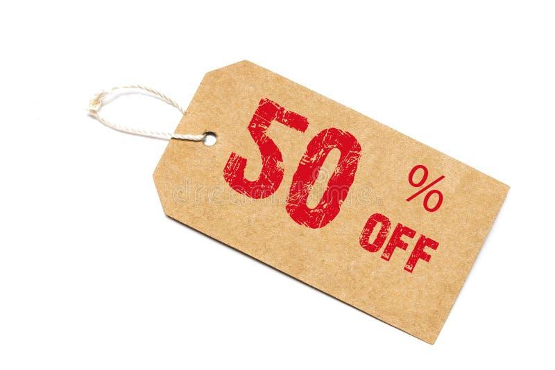 Vijftig percenten van korting - een document prijskaartje op witte backgrou stock fotografie
