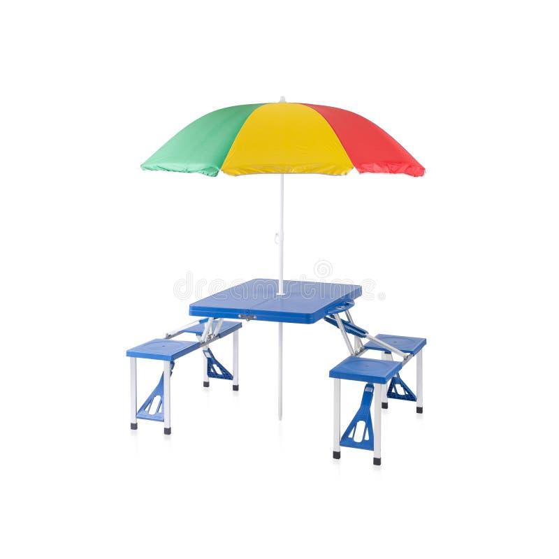 Vik den i stånd och bärbara picknicktabellen med parasollen royaltyfria foton