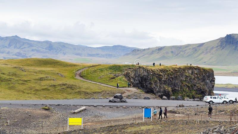 Tourists on viewpoint near Vik I Myrdal village royalty free stock photography
