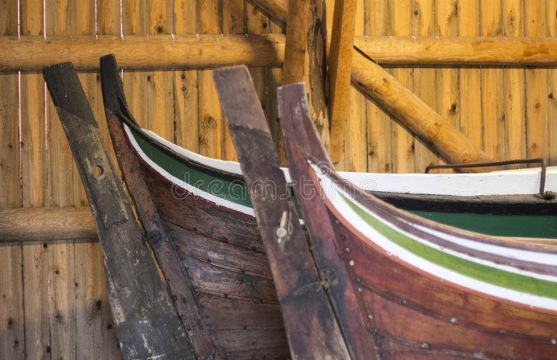 Viking Bows. Two traditional wooden boats manufactured according to Norwegian tradition and painted with green and white stripes. Taken on Lofoten Archipel stock photography