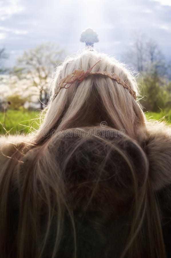 Viking`s pray. Valhalla. Viking girl warrior with the sword on a sky backround royalty free stock image