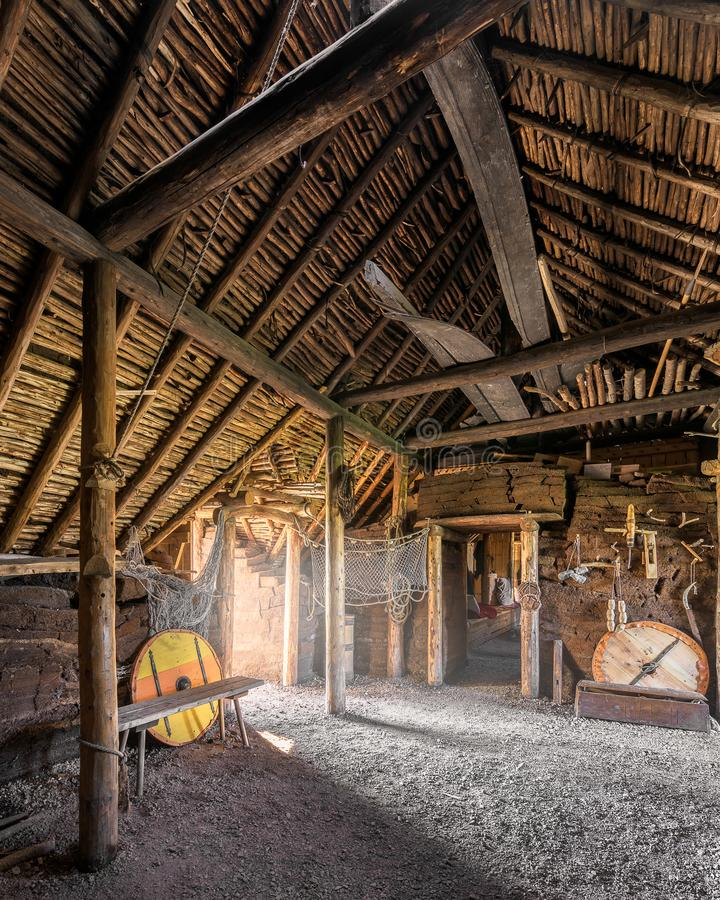 Viking settlement at L`Anse aux Meadows. Interior of a recontructed buildings at an archaeological Viking site on the northernmost tip of the island of royalty free stock image