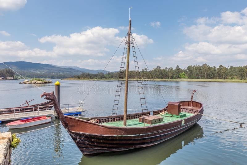 Viking ship at the pier, replica stock photography