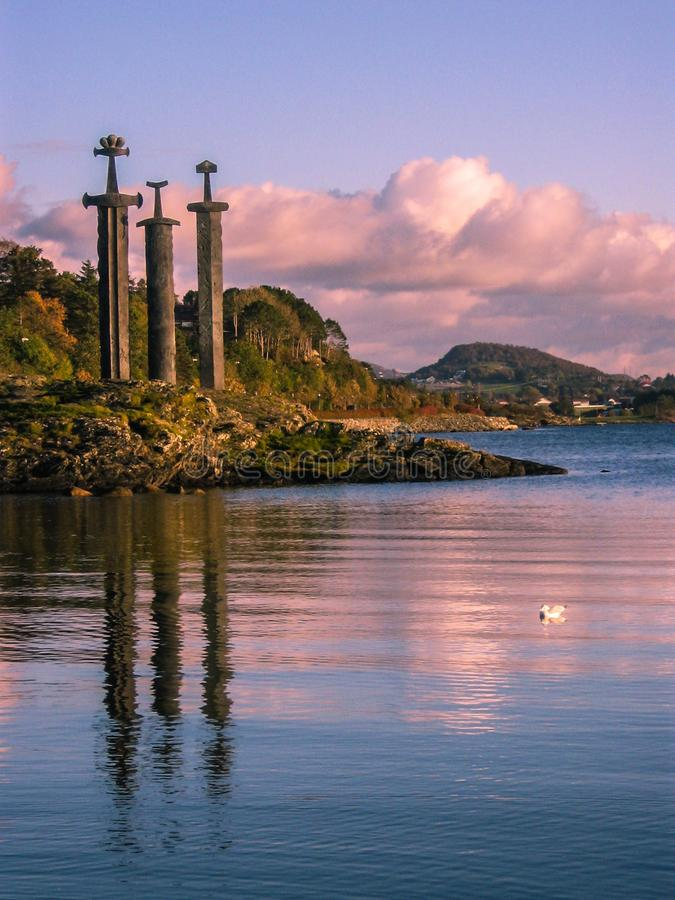 Viking swords. Three Swords Monument at sunset. In Stavanger, Norway royalty free stock images