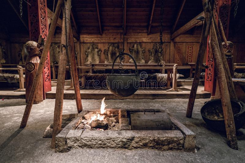 Viking village interior. Cooking pot over the fireplace. Vikings, ancient, warrior concept royalty free stock photos