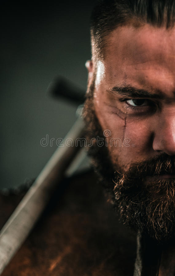 Free Viking With Cold Weapon In A Traditional Warrior Clothes Royalty Free Stock Images - 93978769