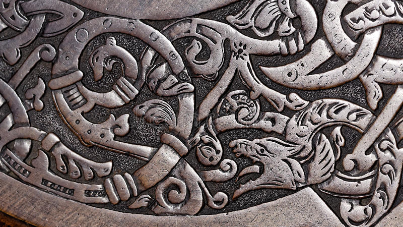 Viking wood carving of a wolf stock image