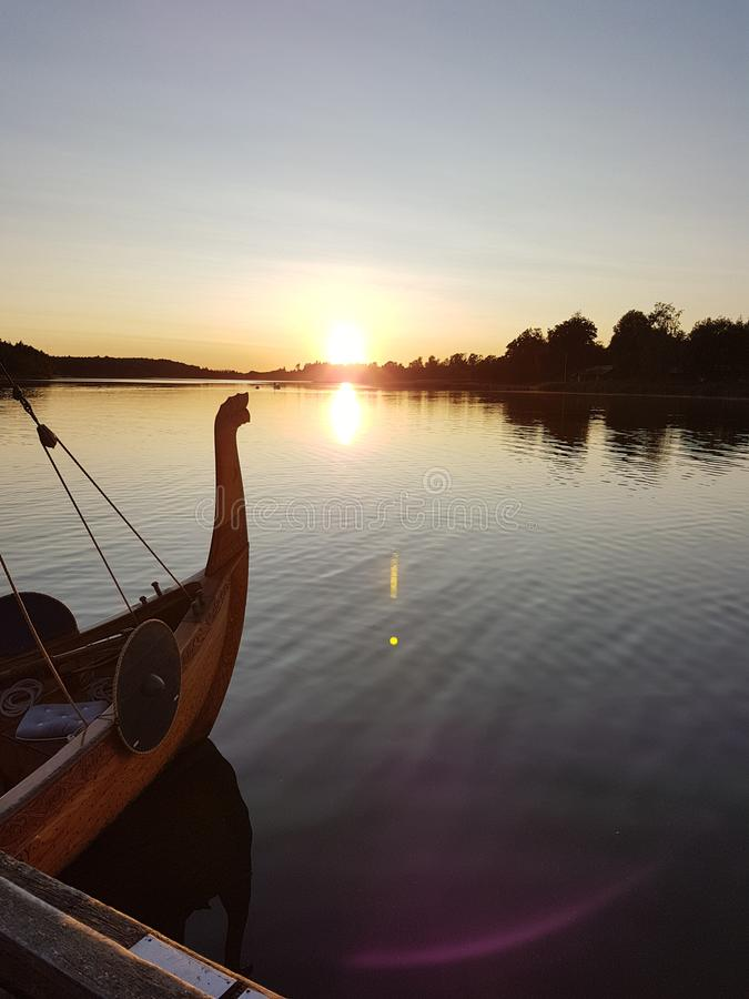 A vikingboat waiting sunset finland sea water royalty free stock image