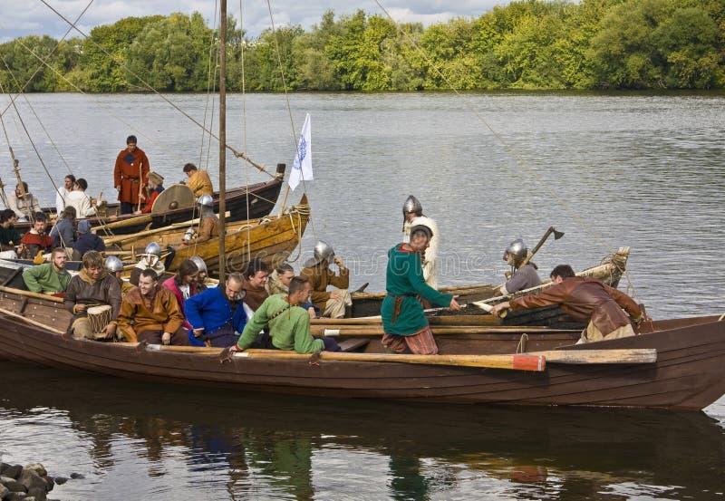 Vikings on boat, historical festival stock image