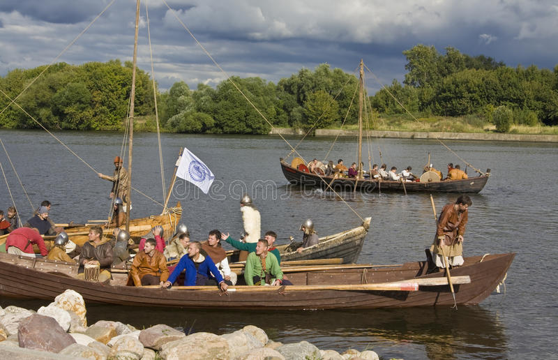 Vikings on boats royalty free stock images