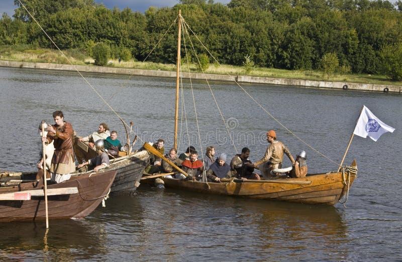 Vikings on boats royalty free stock photography