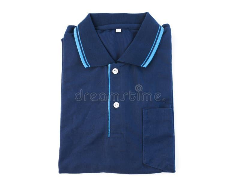 Vikt blå isolerad vit bakgrund för poloskjorta arkivfoto