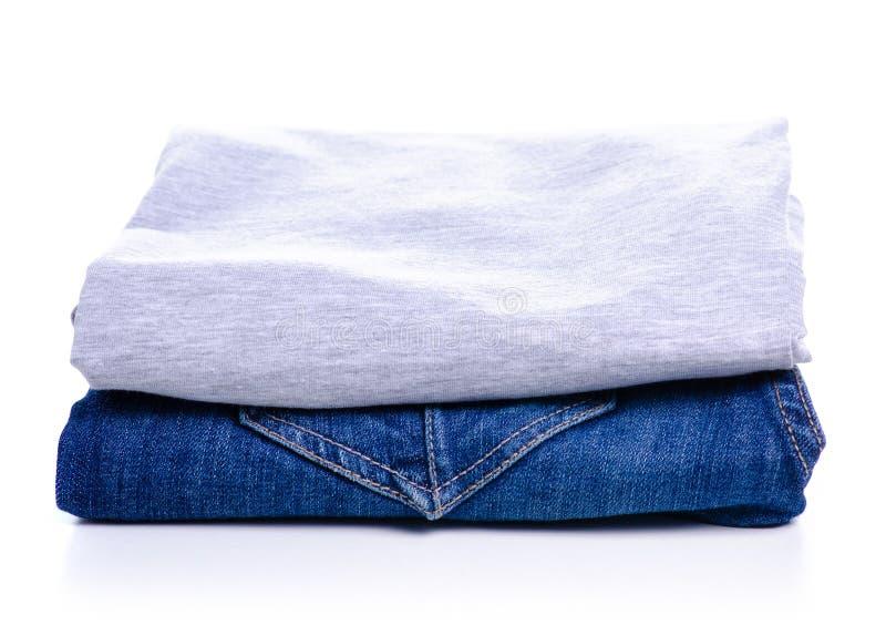 Vikt jeans och grå t-skjorta arkivbilder