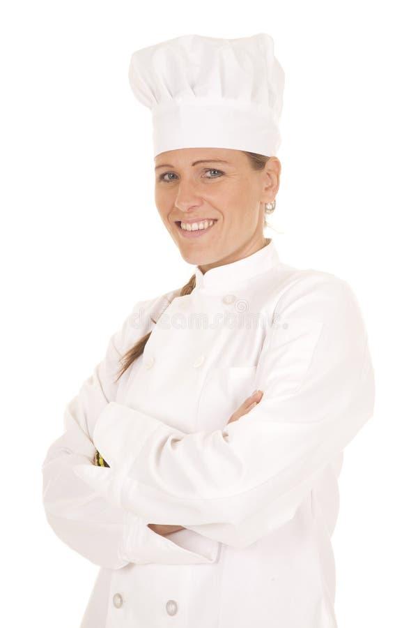 Vikt leende för kvinnakock armar royaltyfri bild