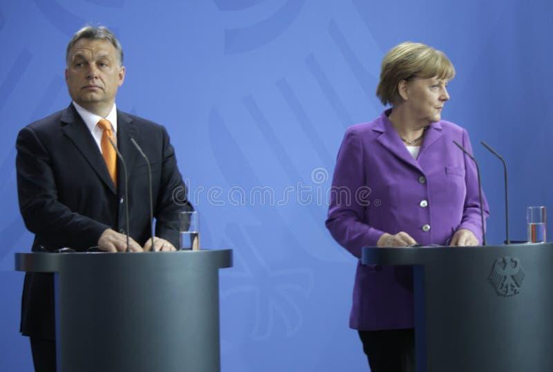 Viktor Orban Angela Merkel royaltyfri bild