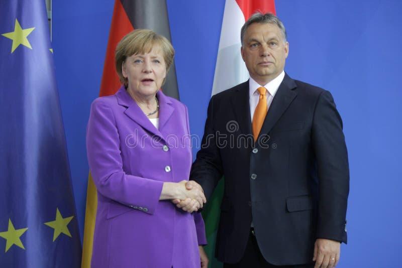 Viktor Orban, Angela Merkel stockbilder