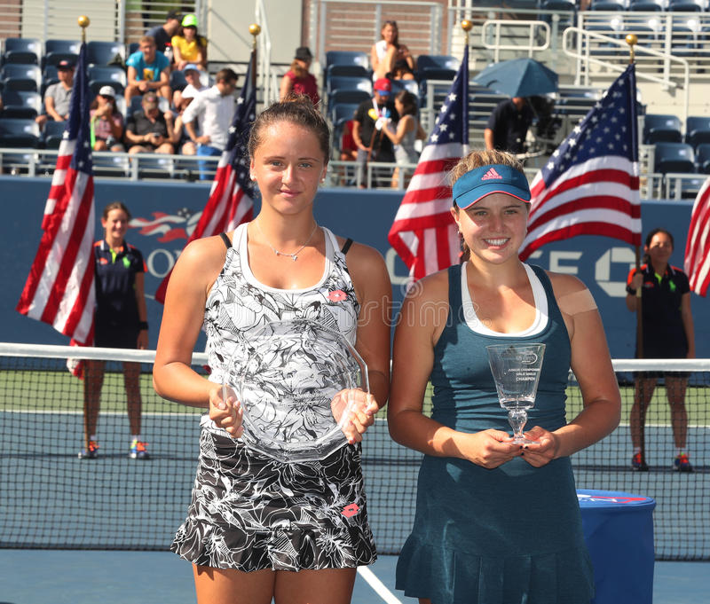 Viktoria Kuzmova (L) of Slovakia and US Open 2016 girls junior champion Kayla Day of USA during trophy presentation. NEW YORK - SEPTEMBER 11, 2016: Viktoria royalty free stock images