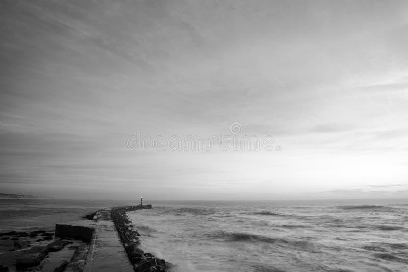 Vila do Conde the shore and lighthouse. Black and white seascape photography the bay of Vila do Conde ocean waves hit the rocks stock photos