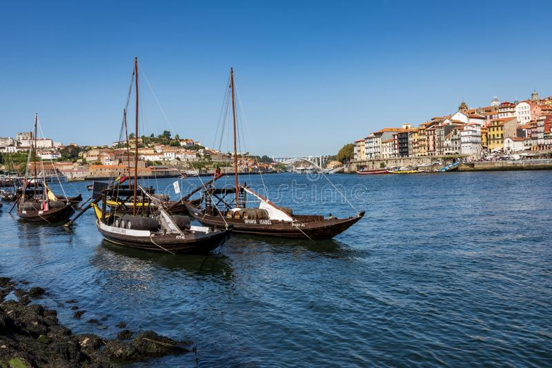 Vila Nova de Gaia, Portugal - September 13, 2019 - Traditional rabelos on the Douro River with Porto in the background. Traditional rabelos used to transport royalty free stock image