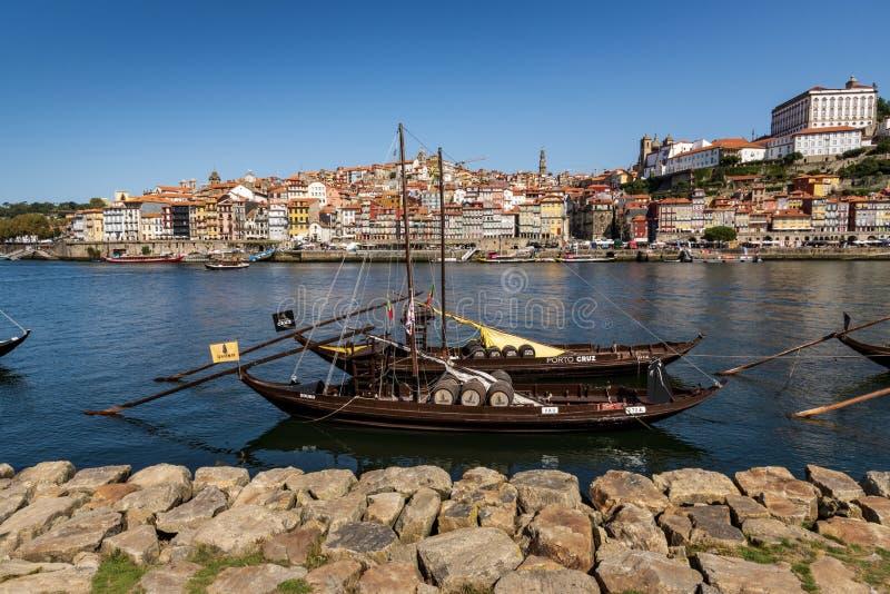 Vila Nova de Gaia, Portugal - September 13, 2019 - Traditional rabelos on the Douro River with Porto in the background. Traditional rabelos used to transport royalty free stock photo