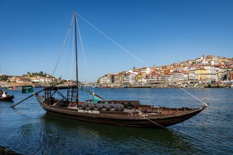 Vila Nova de Gaia, Portugal - September 13, 2019 - Traditional rabelos on the Douro River with Porto in the background. Traditional rabelos used to transport stock image