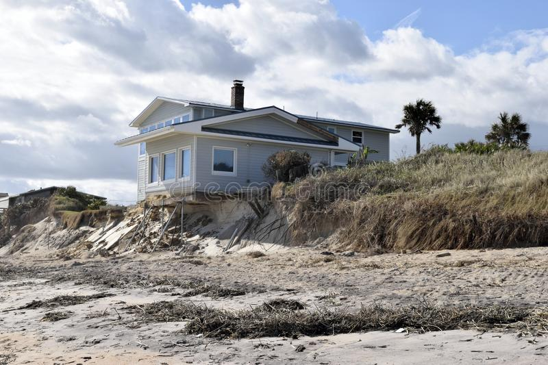 Vilano beach and effect of hurricane. House beside Vilano Beach, Florida, USA, experienced structural damage to its foundations caused by waves during the stock photos