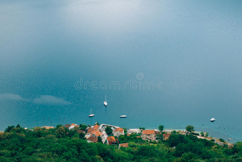 Villa on the beach with a moored yacht royalty free stock image