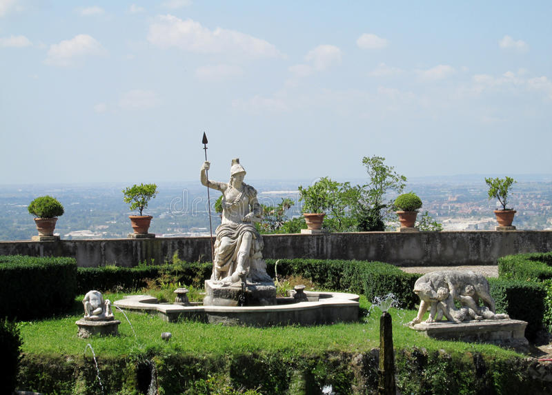 Villa d'Este garden with fountains and antique statues. Villa d'Este fountains and antique marble statues of gods, woman, mythological creatures and heraldic stock photography