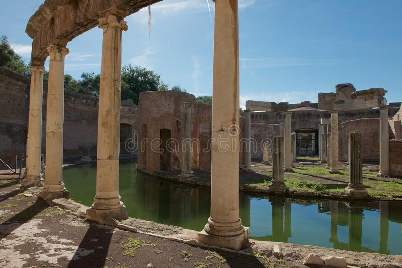Reflections of the Villa of the Island at Hadrians Villa. The Villa of the Island is a unique and one of the best known structures at Hadrians Villa. A moat royalty free stock image