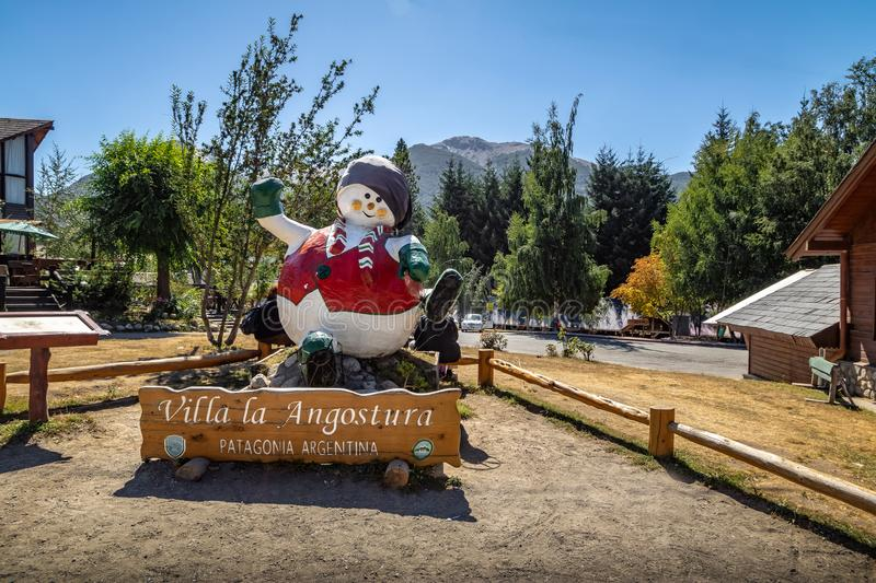 Villa La Angostura Sign and Snowman Statue - Villa La Angostura, Patagonia, Argentina royalty free stock photo
