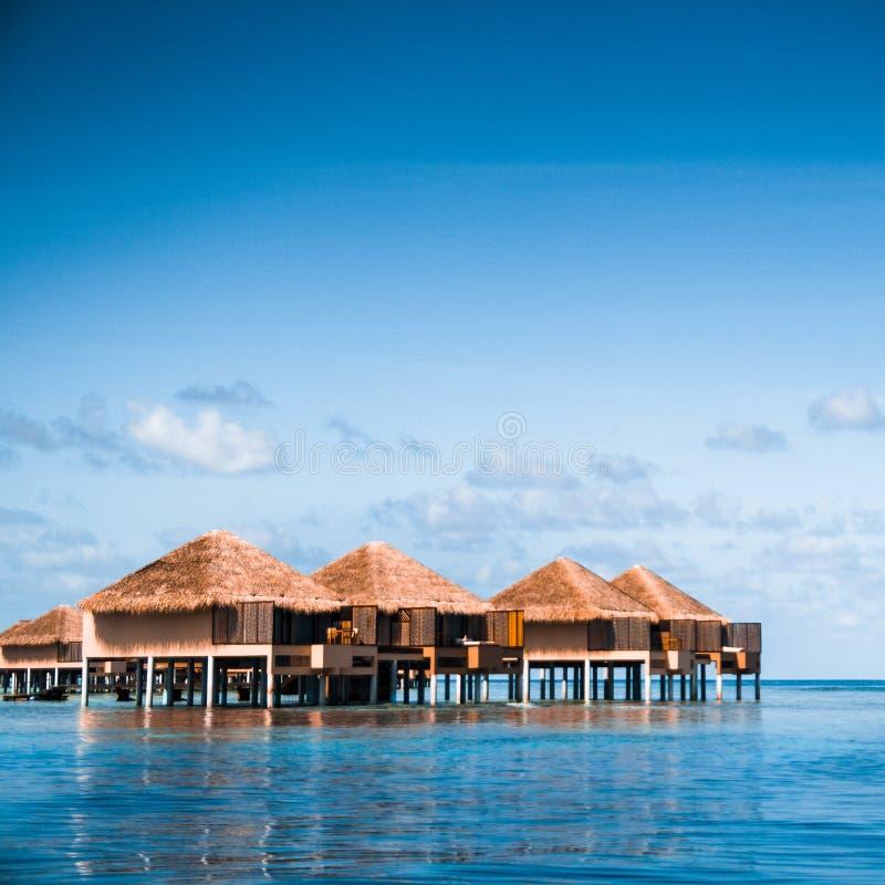 Villa on piles. On beautiful beach royalty free stock photos
