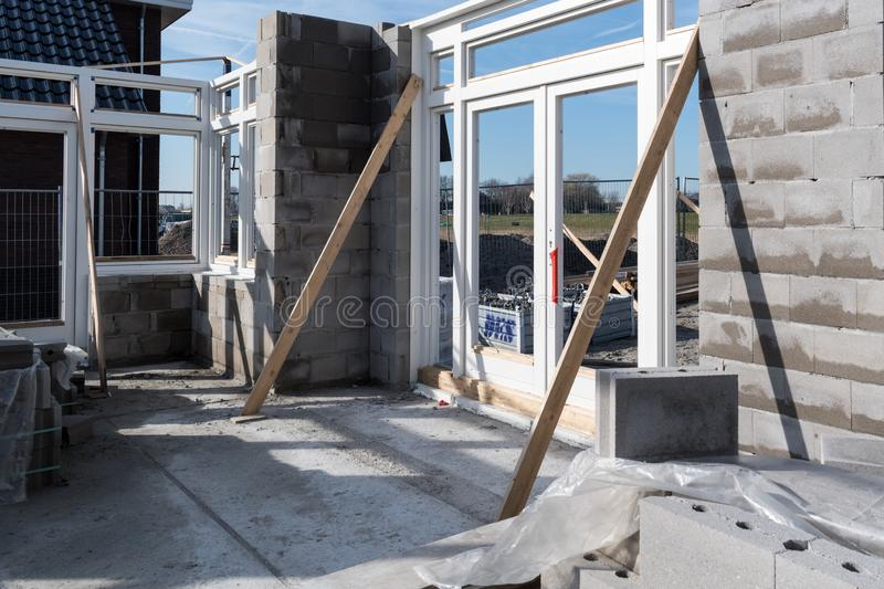 In a villa under construction the first frames are placed royalty free stock image