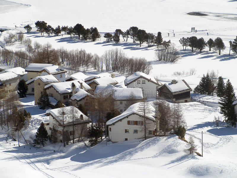 Village. Snowy village in the Alps (switzerland royalty free stock photography