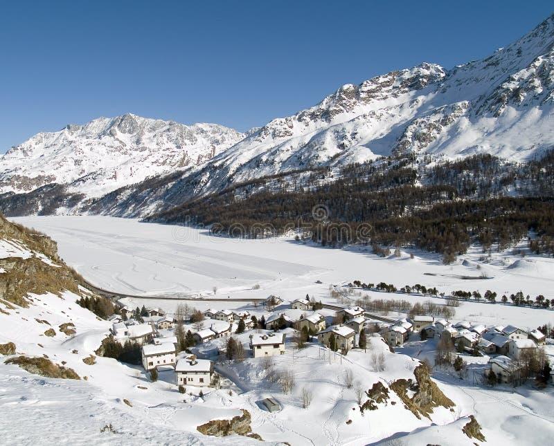 Village. Snowy village in the Alps (switzerland - Maloja royalty free stock photography