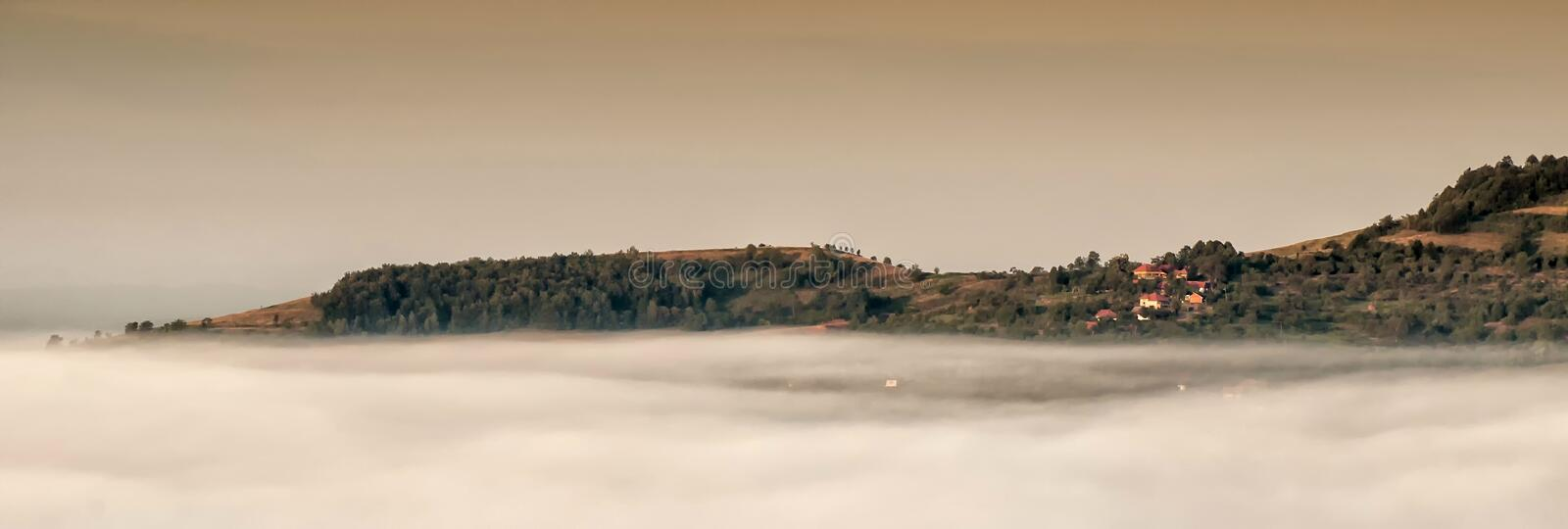 Village above the clouds stock images