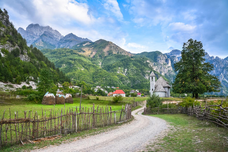 Village with an ancient church in the mountains royalty free stock photo