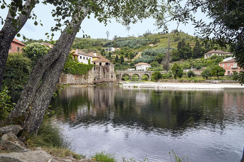Village of Avo. View of the beautiful portuguese historic village of Avo from the lake, formed by the river Alva and the Pomares, Oliveira do Hospital in stock photo