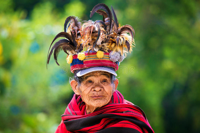 The village of Batad, Philippines March 3, 2015. Close-up portrait of an unknown old woman in national costume Ifugao tribe. royalty free stock photo