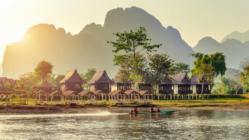 Village and bungalows along Nam Song River in Vang Vieng, Laos.  royalty free stock image