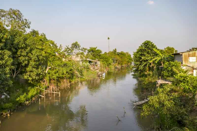 Village on channel waterfront in Mekong Delta of Vietnam royalty free stock image