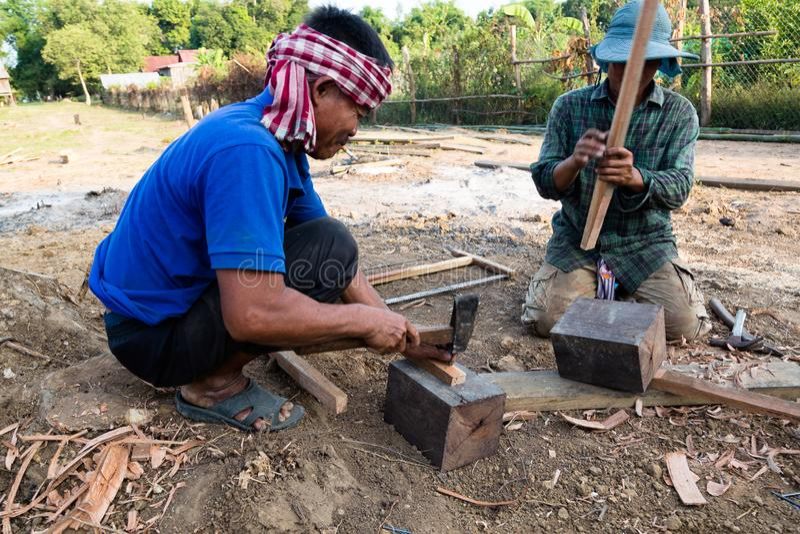 Village Chief manufacturing tools, Kratie, Cambodia, December 7, 2018 stock photo